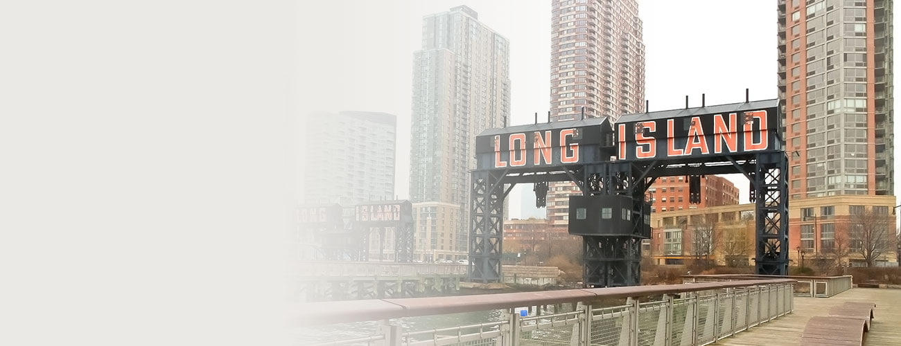 Modern pier with 'Long Island' painted on in Gantry Plaza State on foggy day, Queens, New York